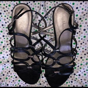 Black strappy sandals with silver accents
